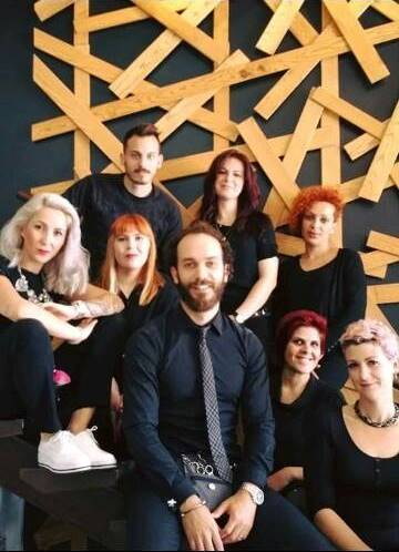 Bradley Querl (center) and Vania Querl (right) with the B Hair Design team.